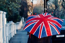 Person With British Flag Umbrella On Sidewalk