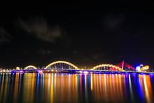 View Of Illuminated Dragon Bridge Over River