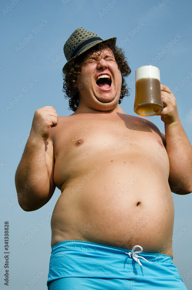 Fototapeta Funny fat guy and beer.