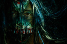Close-up Portrait Of Woman With Halloween Make-up Over Black Background