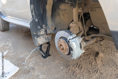 Photo View of the front axle of a car without a wheel
