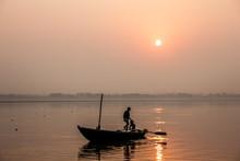 Fishermen At A Sunrise