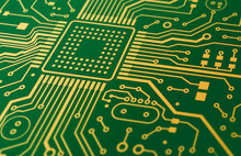 Computer Hardware. Illustration Of Green Circuit Board With Golden Lines, Closeup