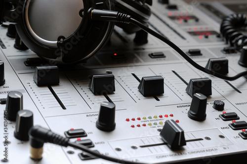 Obraz na plátne A close up of a professional Dj mixer and headphones.