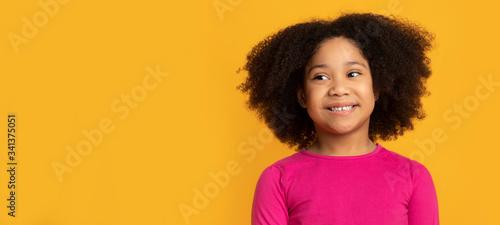 Obraz Portrait of lovely african american kid, little girl over yellow background - fototapety do salonu
