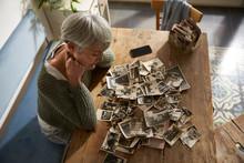 Senior Woman Watching Old Phot...