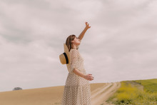 Woman In Vintage Dress Alone At A Remote Field In The Countryside