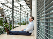 Businessman In Green Atrium, S...