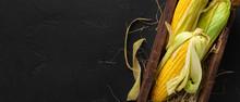 Yellow Corn Cobs On Black Back...