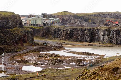 Photo An open cast quarry, used for extracting rock, stones and other aggregates for t