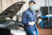 Masked Car Mechanic Holding A ...