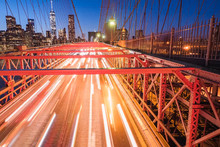 Blurred Motion Of Cars On Brooklyn Bridge In City At Night
