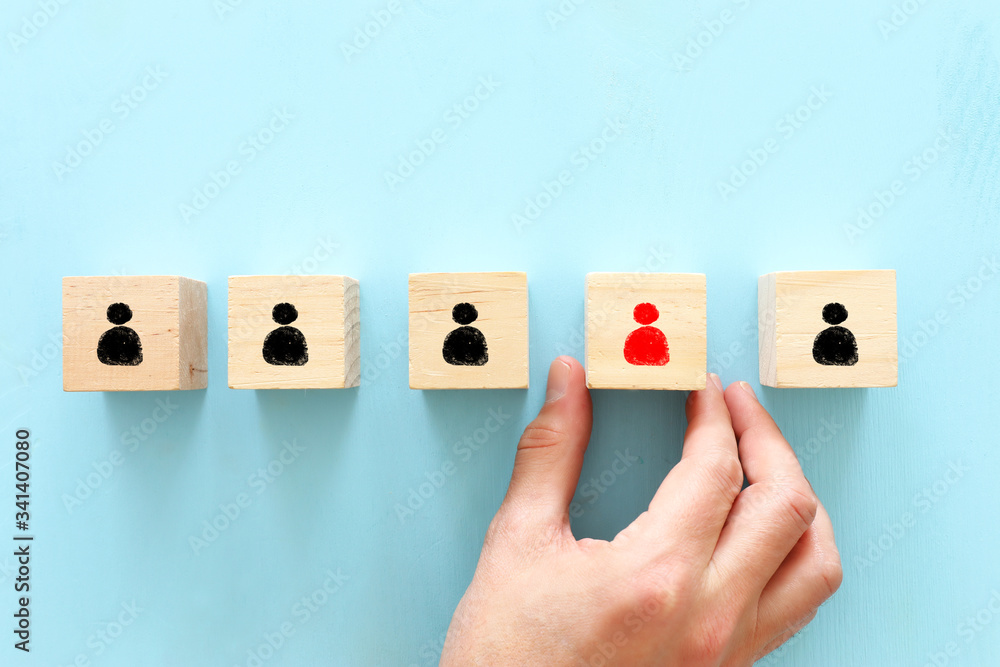 Fototapeta image of wooden blocks with people icons over wooden table ,human resources and management concept