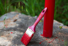 Red Paint Brush Thrown On A Me...