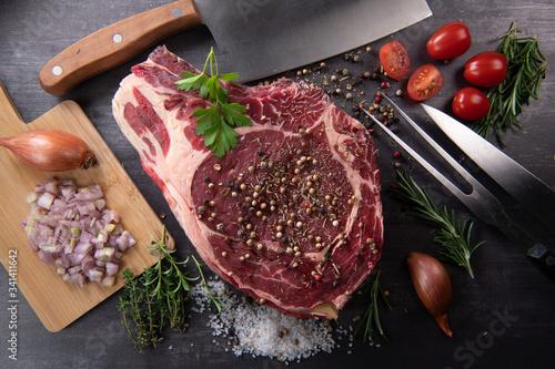 Fotografiet Raw T Bone steak entrecote prepared to Grill on turntable