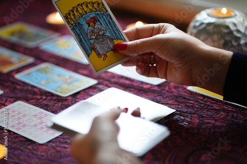 Moscow/Russia- April 2020: Tarot card reader arranges cards in a  card spread Canvas Print