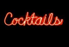 Illuminated Cocktails Text Against Black Background