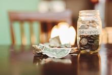 Mason Jar Filled With Coins Al...
