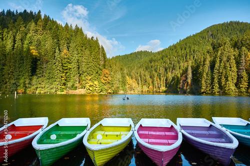 Multi-colored boats at the pier on Lake Lacu Rosu, Romania Wallpaper Mural