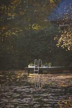 Gazebo Floating On Lake During Autumn