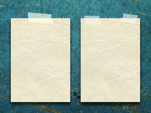 Close-up Of Papers Against Blue Background