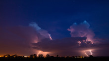 Lightening Over Silhouette Landscape At Night