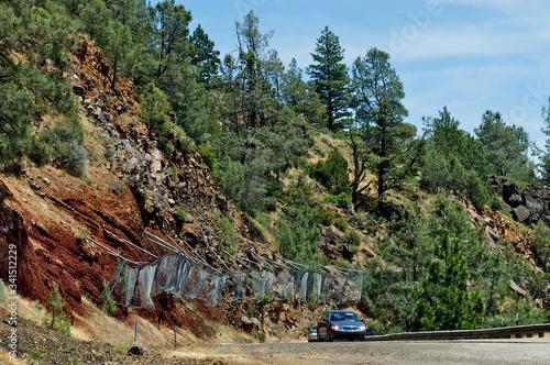 Fotografie, Obraz Rockfall barrier fence, highway 299, California