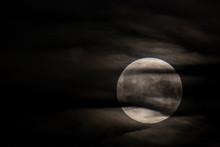 Moon Between Clouds In Montser...