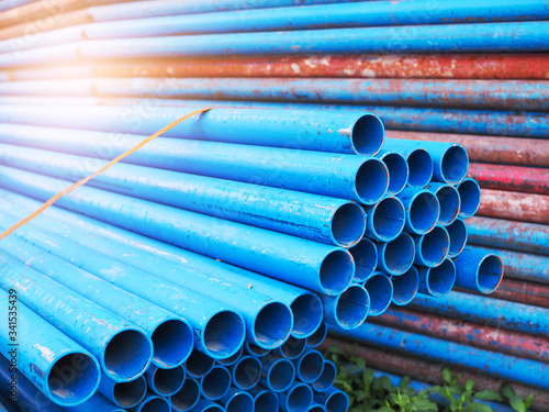 Obraz Blue steel pipe pile stacked on construction site. - fototapety do salonu