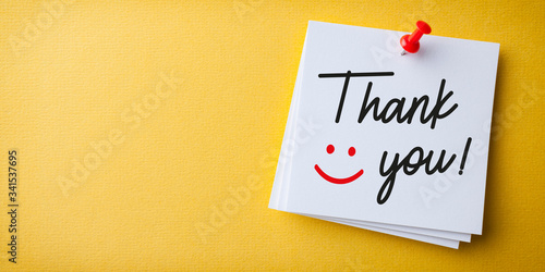 Obraz na plátně White Sticky Note With Thank You And Red Push Pin On Yellow Background