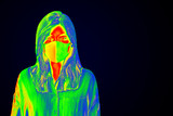 Woman wearing a face mask during coronavirus pandemic thermal image - 341539051
