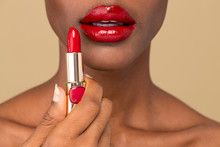 Black Woman Applying Red Lipst...