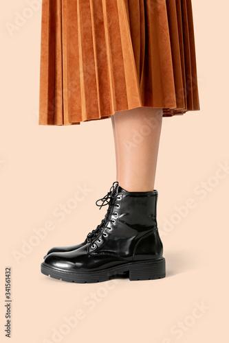 Cuadros en Lienzo Woman in a skirt wearing combat boots