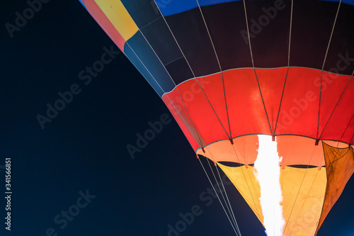 Photo colorful Hot air balloon ready for take off in sky in night