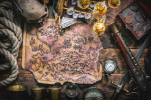 Pirate Captain Desk With Various Adventure Accessories. Treasure Map On The Table.