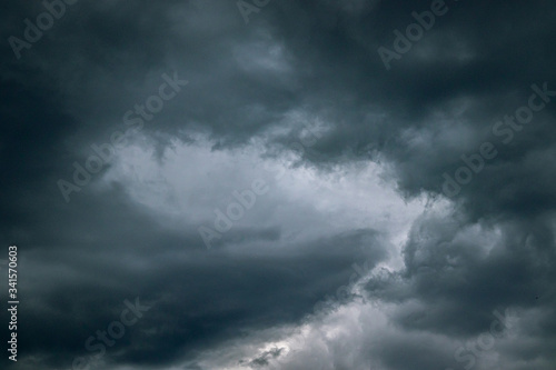 Storm clouds over the city Wallpaper Mural