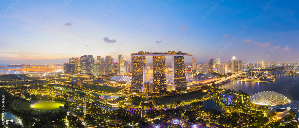 Fototapeta SINGAPORE - FEBRUARY 2: Aerial drone view of Singapore business district and city, Business and financial district Modern building in the city center of Singapore on February 2, 2020 in Singapore.