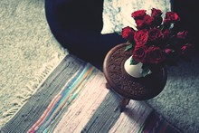 High Angle View Of Red Roses In Vase On Table At Home