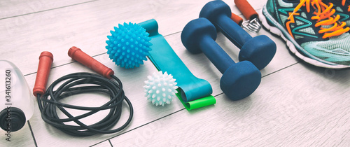 The fitness tools and  a equipment on the wooden floor Wallpaper Mural