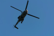 A Military Helicopter Flies Lo...