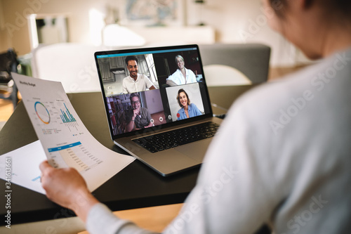 Leinwand Poster Businesswoman having online business meeting from home