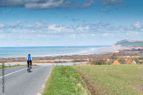 Photo Cyclist on a road in the Opal Coast, France, Pas de Calais