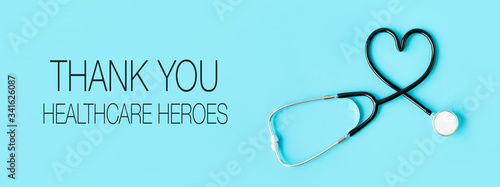 Cuadros en Lienzo Thank you healthcare heroes message with stethoscope forming a heart on pastel blue background