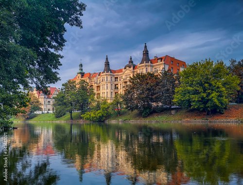 Epic palace behind river in stormy day in Wroclaw City