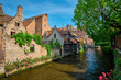canvas print picture - Canal between old houses of famous Flemish medieval city Brugge. Bruges, Belgium