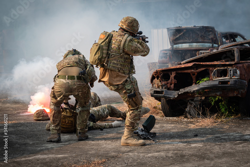 Special Forces soldiers combat uniforms fighting in battle aiming gun rifle to a Canvas Print