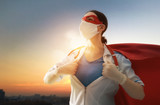 Doctor wearing facemask and superhero cape - 341663217