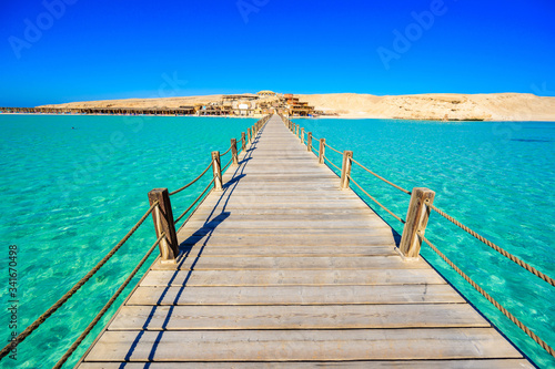 Wooden Pier at Orange Bay Beach with crystal clear azure water and white beach - paradise coastline of Giftun island, Mahmya, Hurghada, Red Sea, Egypt Fototapet