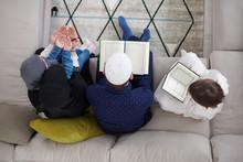 Muslim Family Reading Quran An...