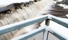Snow On Metal Railing Over River